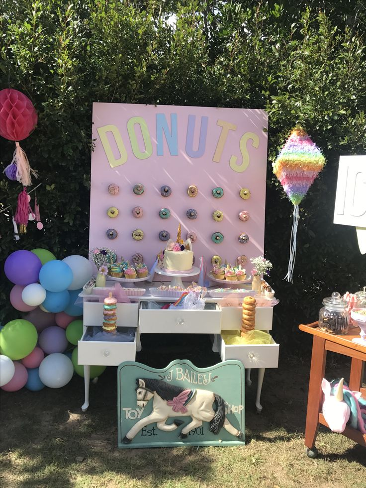 Pastel rainbow unicorn party, donuts and sweets