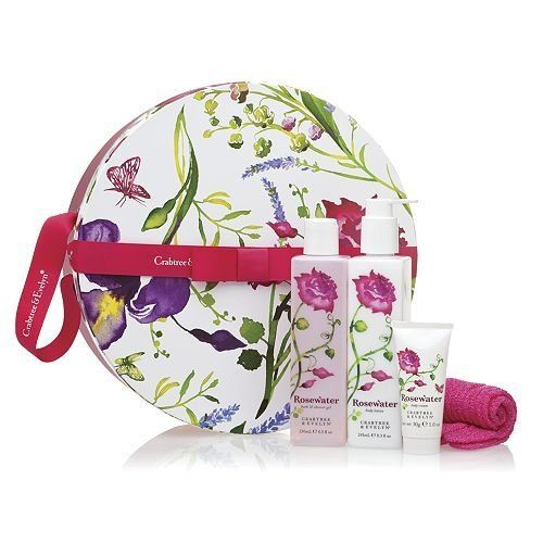 Crabtree & Evelyn Rosewater Hatbox Round (bath & shower gel 8.5oz, body lotion 8.3oz, body cream 1oz & exfoliating gloves) by Crabtree & Evelyn. $38.40. Rosewater Bath & Shower Gel (250mL). Exfoliating Gloves. Rosewater Body Lotion (245mL). Rosewater Body Cream (30g). This lovely paper-covered gift box features a beautiful floral print and holds three luxurious rosewater body care gifts, along with skin-smoothing exfoliating gloves.. Captivating rosewater surrounded ...