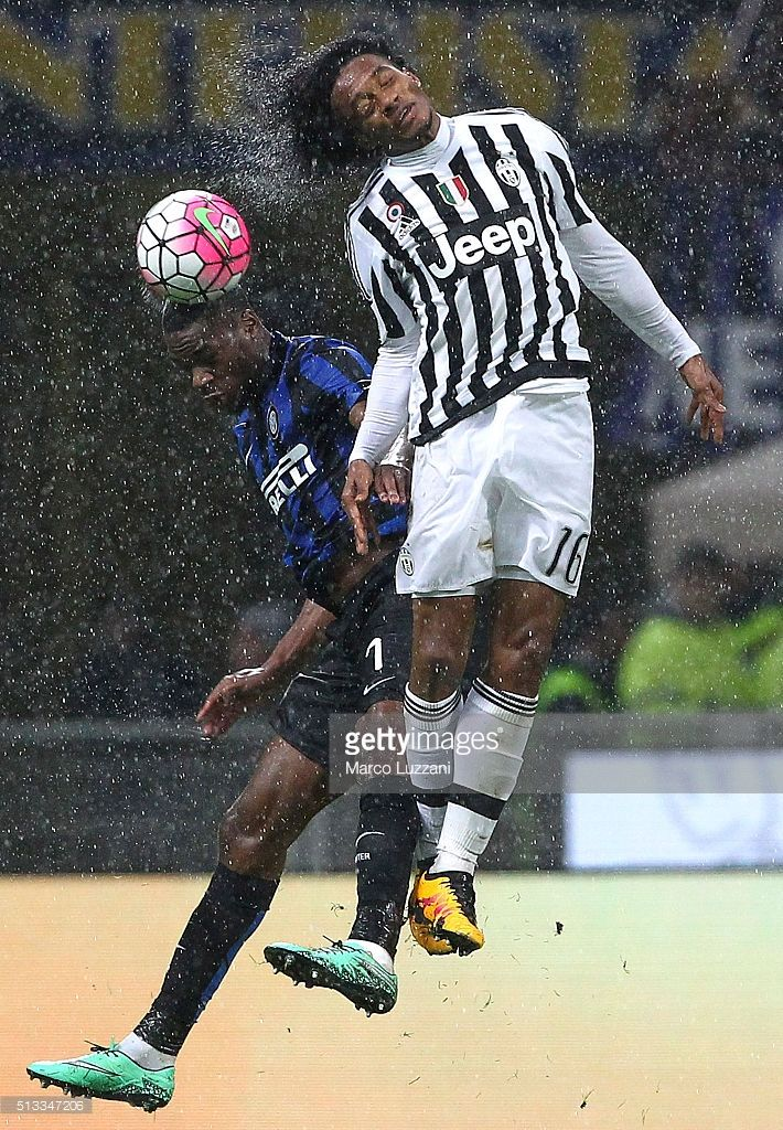 Geoffrey Kondogbia of FC Internazionale Milano competes for the ball with Juan Cuadrado of Juventus FC during the TIM Cup match between FC Internazionale Milano and Juventus FC at Stadio Giuseppe Meazza on March 2, 2016 in Milan, Italy.