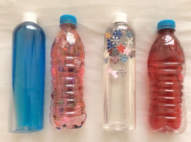 Bottles with Coulored Water and Shiny Charms