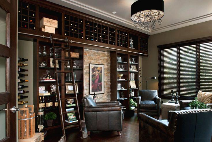 Книги и разные мелочи — далеко не единственные вещи, которые можно хранить на стеллажах в гостиной. Деревянный бар, оборудованный под потолком, будет отлично смотреться и сделает комнату намного уютнее. Здесь без приставной лестницы уж точно не обойтись.