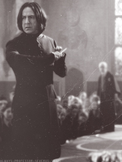 "2002 - Alan Rickman as Professor Severus Snape in the 2nd Harry Potter movie: ""Harry Potter and the Chamber of Secrets."" This shot is during the ill-fated dueling club started by the DADA ""teacher,"" Gilderoy Lockhart."