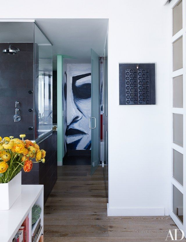 The master bath features a hand-painted mural by Miami street artist Subi Roberto | archdigest.com