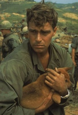 A soldier coping with his dog during the Battle of Khe Sahn, 1968.