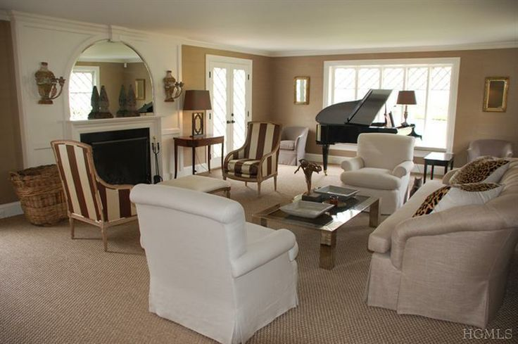 ... over fireplace, comfortable seating arrangement in sunny living room