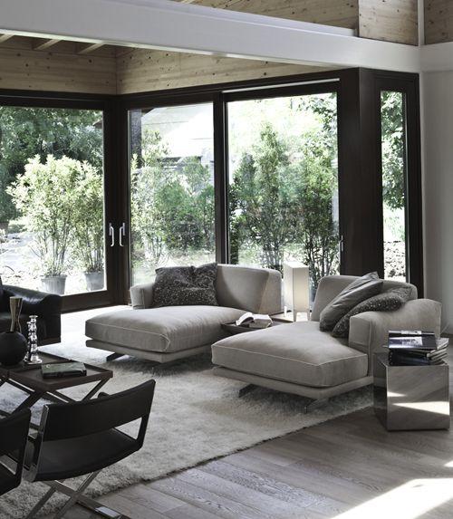 Grey modern living room with beautiful glass window walls.