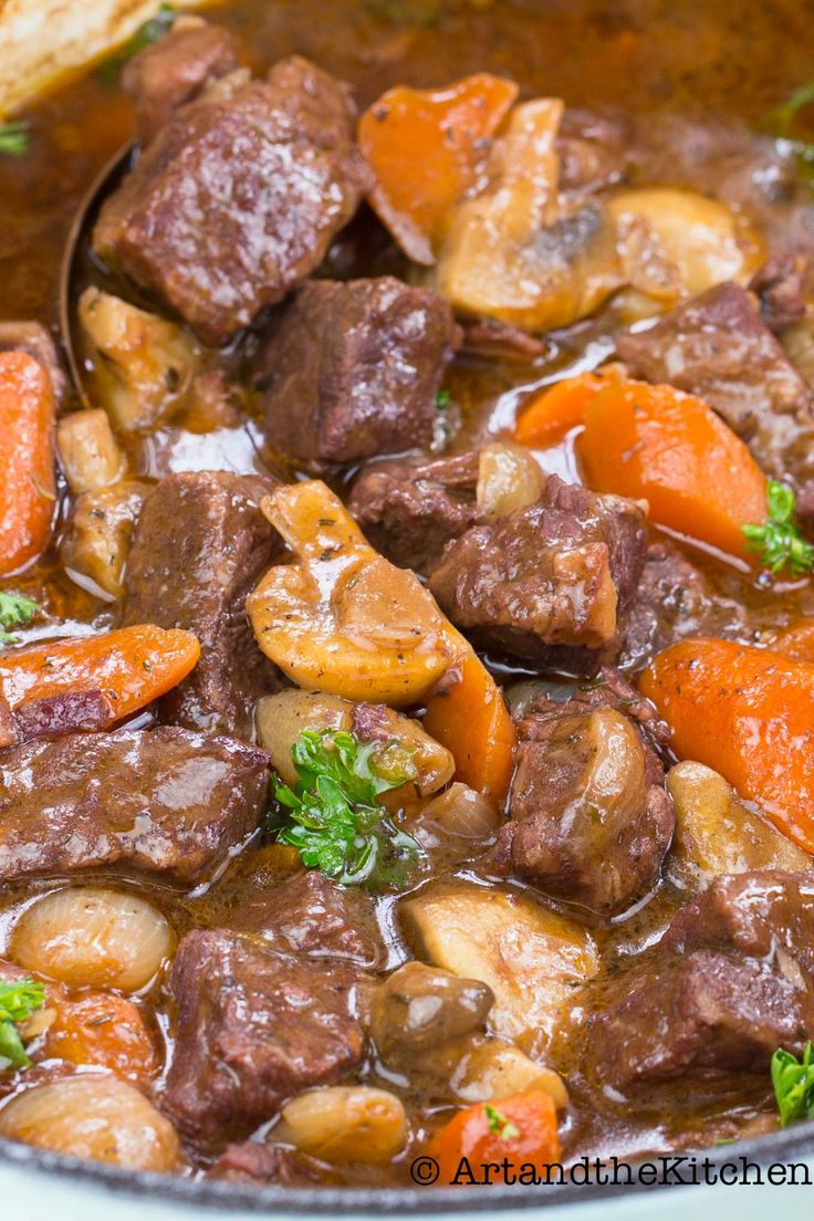 This recipe for Beef Bourguignon serves up fork tender beef , carrots, pearl onions and mushrooms in an amazing tasting red wine rich aromatic sauce.