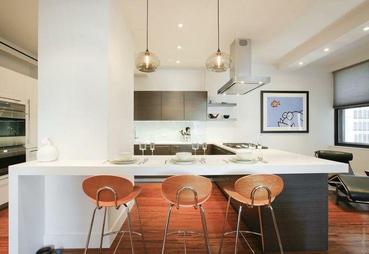 Cовременная квартира-студия на Манхеттене  Вашему вниманию представлен проект современной квартиры от Американской компании Bazzo NYLOFT. В ее дизайне автор умело соединил деревянную облицовку цвета древесного угля, белые лакированные столешницы и алюминий.