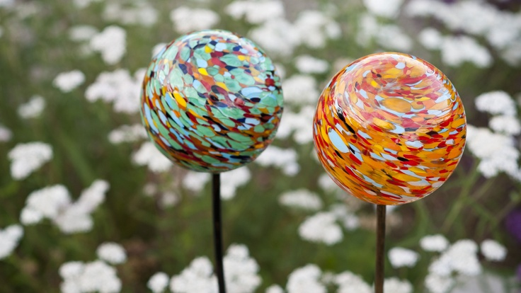 Solar Powered Garden Orb Lights  By Allsop Home & Garden  These rechargeable, solar-powered garden lights will give your garden or patio a magical glow. Handmade by artisan glassblowers, these stunning orbs are as beautiful as they are functional.    $50