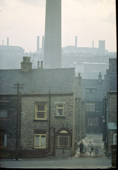 News Photo: Terraced houses near a factory in the north…