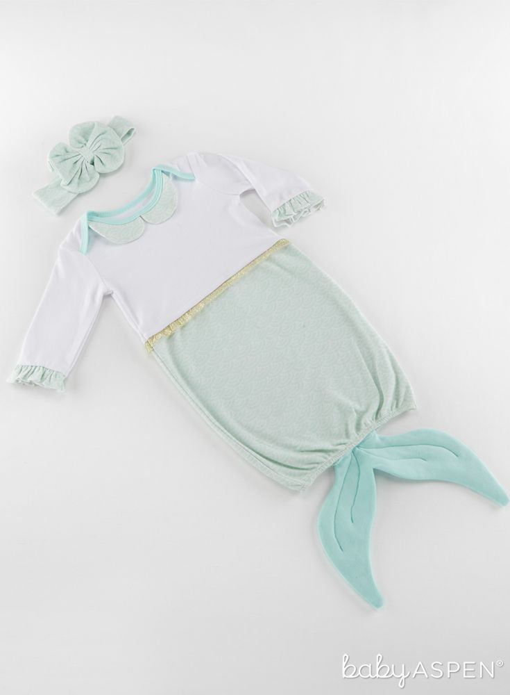 From playtime to sleep time, Baby Aspen's Simply Enchanted Mermaid 2-Piece Layette Set is just that - enchanted! Featuring a sweetly scalloped nightgown with mermaid tail and matching headband, your little mermaid will look so cute adorned in this set!   Simply Enchanted Mermaid 2-Piece Layette Set   Baby Aspen