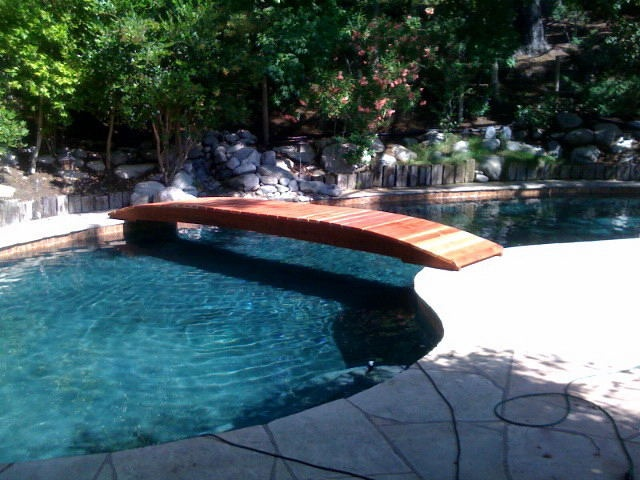12 best bridge over pool images on pinterest for Koi pond next to swimming pool