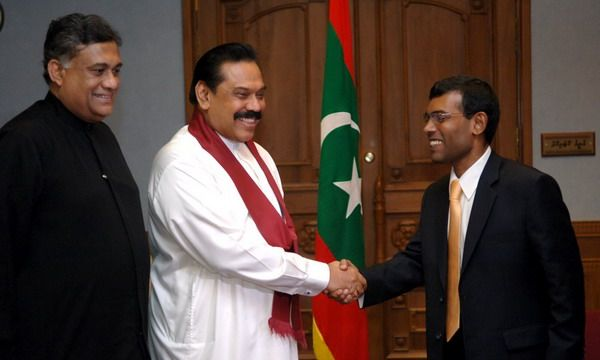 iSri Lanka President Mahinda Rajapakse  congratulates Mohamed Nasheed (Anni),   new President of Maldives. Also Sri Lanka's Foreign Minister Rohitha Bogollagama was with Sri Lanka President to felicitate the new Head of Maldives