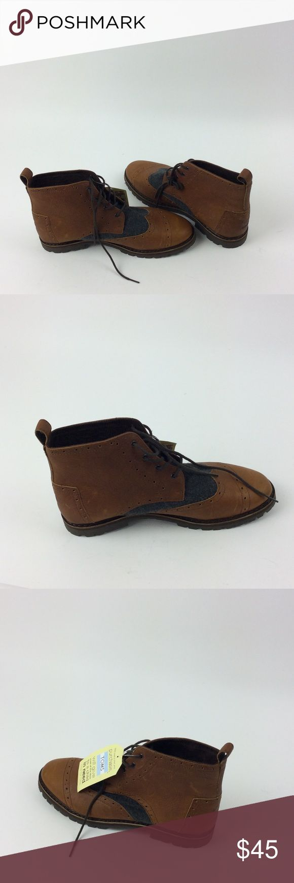 New TOMS Men Brogue Boot Brown leather and grey wool upper.                      Classic brogue detailing and wingtip toe.             Molded, removable footbed that fights bacteria.                                                                      Lug outsole for no-slip grip.                                      Pull tab for easy on and off.  Bin: A33 Toms Shoes Boots