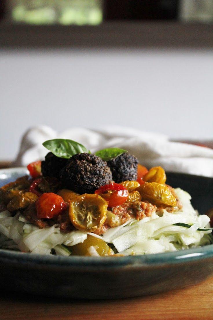 marinated zucchini noodles with tomato basil sauce, dried baby tomatoes + garlic portobello meatless balls