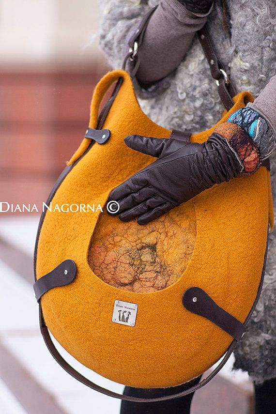 It is very bright and cozy felted bag , color of ripe mango. Made of natural wool, with the technique of hot felting.  Handmade . unique item. The bag is very comfortable and roomy. inside there is a lining with a pocket. Handle and decorative elements are made from high quality genuine leather dark brown. You can also use an external pocket for various small things or gloves.   Real colors may slightly differ from their appearance on your display, as it depends on your monitor settings