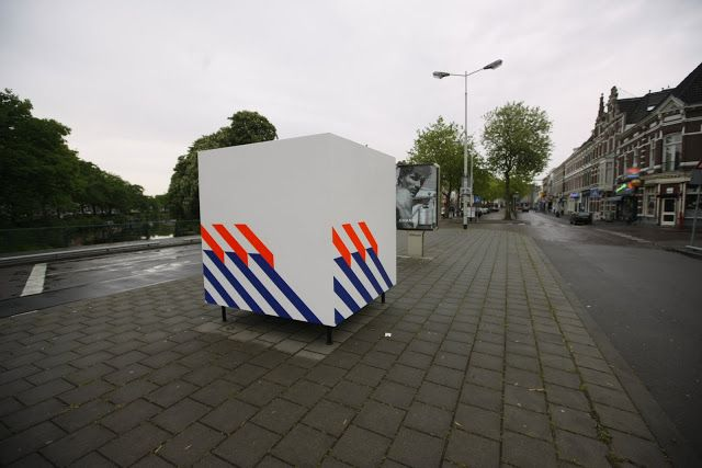 Sil Krol - White Cube with Blue and Orange Stripes, Illegal intervention, wood, steel, police striping, Breda, 2010.  #art #intervention #illegal #contemporary #public #dutch #police #striping #graphic #design
