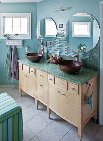 sleek beach style bathroom using light wood vanity and twin round wall mirror long island beach house