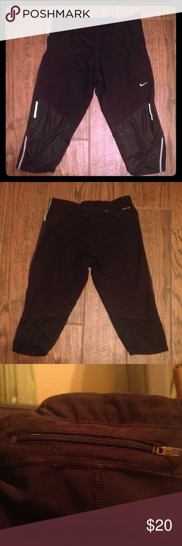 Cropped NIKE Running Pants 💥SUNDAY SALE💥 Cropped NIKE DRI-FIT Running Pants with reflectors. Zip pockets in back waistband and on legs.  SALE PRICE IS FIRM Nike Pants Track Pants & Joggers