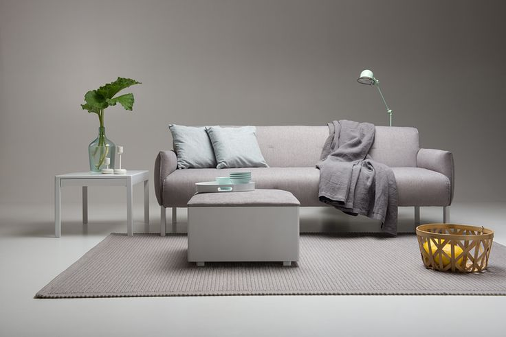 Taru sofa, Satu coffee table and Taika footstool designed by Petra Lassenius, Junet