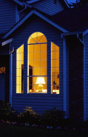 Night Windows Looking Into A Large Night Time Window Of A
