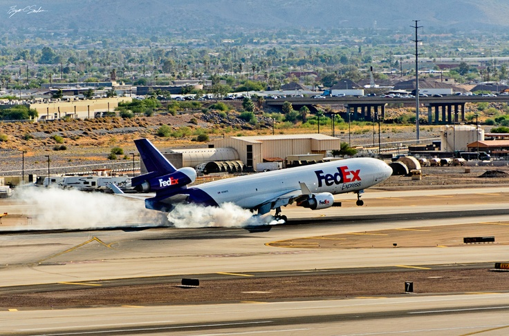 FedEx MD11 touches down on runway 25L at Phoenix Sky