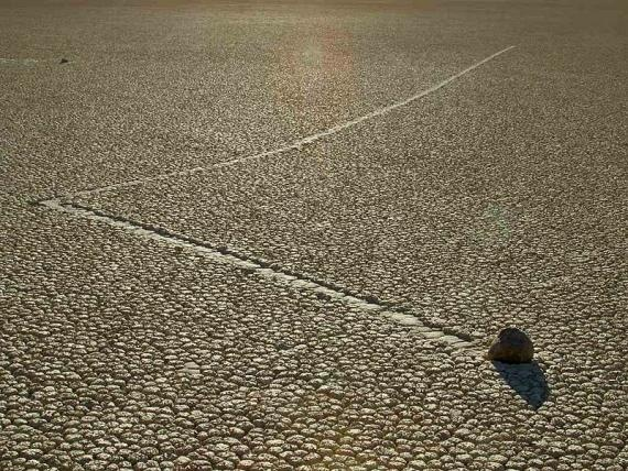 There is something utterly magical about the sailing stones of the Racetrack Playa (sometimes called the Devil's Racetrack) in Death Valley California. Scattered about the desert are large rocks with mysterious trails left behind them. The trails show that these rocks have rolled and zig-zagged across the ground, sometimes for as long as 860 feet.