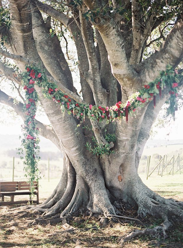Under a wedding tree, outdoor wedding ceremony location under a beautiful red floral garland  | www.onefabday.com