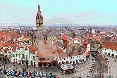 Wide shot of Sibiu city old town in Romania. The Lutheran Cathedral tower in the middle.