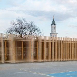 Jovan+Mitrović+wraps+a+glass-walled++sports+hall+in+protective+timber+battens