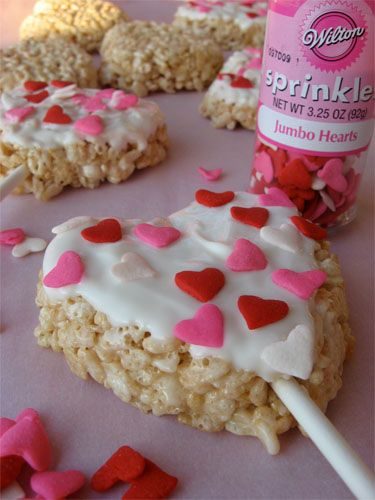Heart Rice Krispie Pops ... click to see the fun begin using heart shaped cookies cutters on a sheet of rice krispies ( OR.. heart shaped moulds )