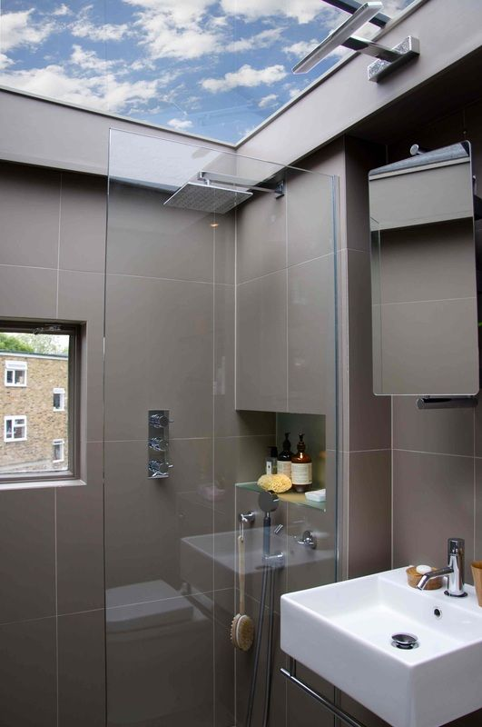 Tiny bathroom with full skylight roof. If we were staying here and n this house I would so do this!!!