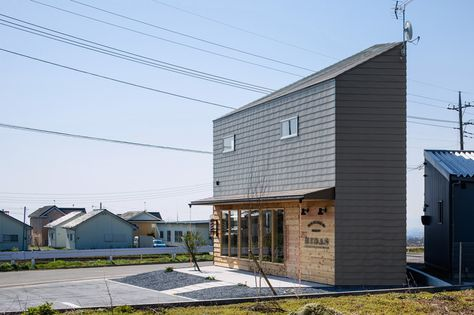 SNARK OUVI's timber dwelling houses a barber shop at ground level - designboom | architecture