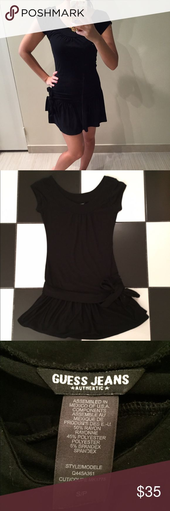 Black Guess dress with bow Black Guess dress with bow. Gently used in good condition. Please use offer button and ask all questions before purchasing. No trades. Guess Dresses Mini