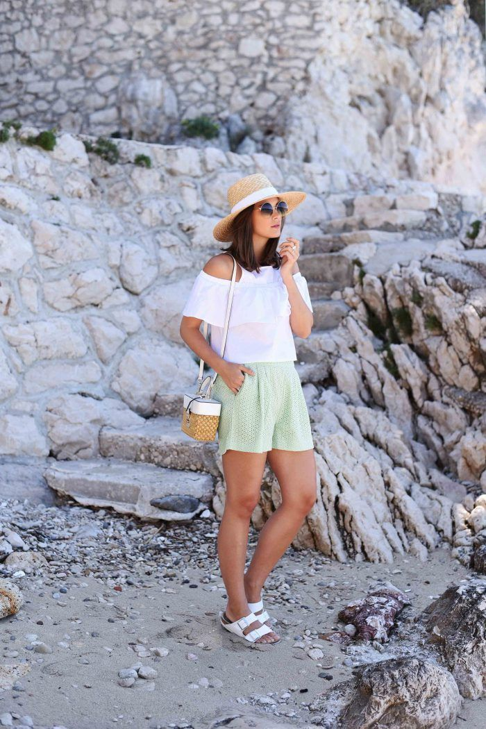 Summer outfit: straw hat, white off-the-shoulder top, mint shorts, Michael Kors straw bag, white sandals