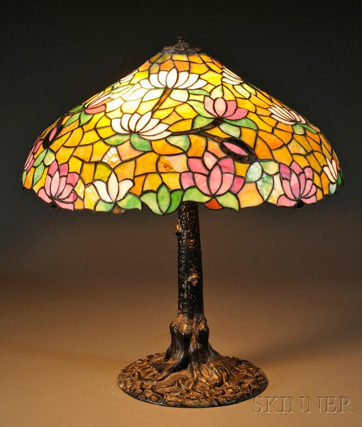 Water lily lamp attributed to chicago mosaic art glass and metal domed shade in water lily pattern in pink and white on variegated green ground over