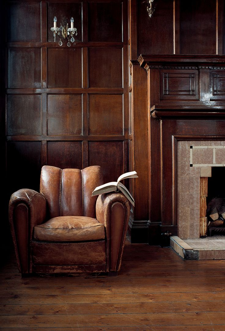 Man Cave Want List: Beautifully Worn Leather Club Chair + Timber Paneling +  Classic Fireplace