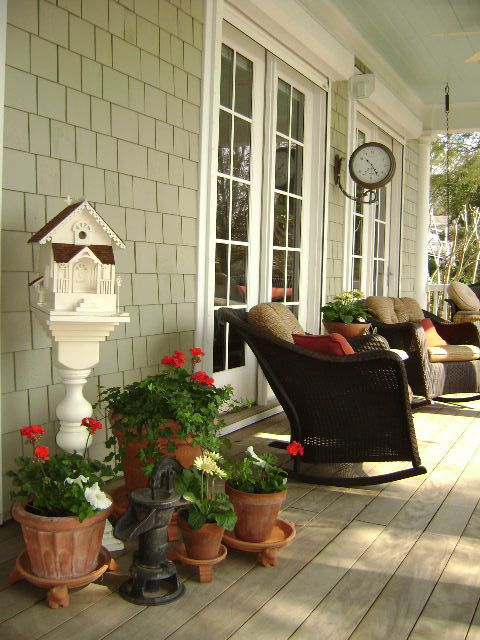 Perfect Southern Front Porch: close up. Love the dark wicker & the station clock.  Front Porch Eddie Rider Designs.