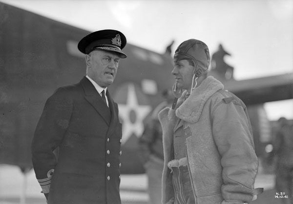 Vice-Admiral Sir Humphrey Walwyn (left), Governor of Newfoundland and Labrador, at RCAF Station, Gander, Newfoundland and Labrador, October 14, 1941 / Le vice amiral sir Humphrey Walwyn (à gauche), gouverneur de Terre Neuve-et Labrador, sur une base de l'   by BiblioArchives / LibraryArchives