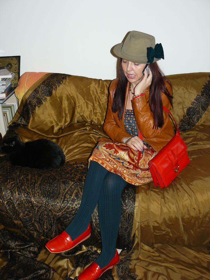Vintage 70s skirt (worn as a dress), vintage bag, vintage fedora, green vintage 70s bow tie (attached to the hat), tan leather jacket and dark green tights