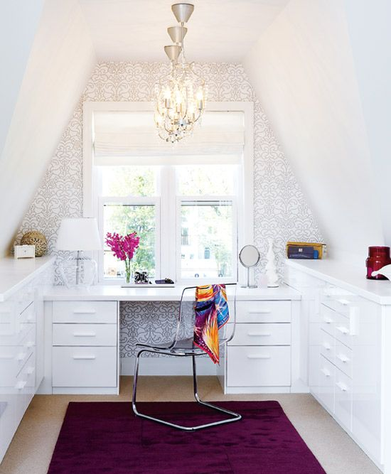 Wallpaper helps turn a nook into a proper office/vanity area (via Style at Home).