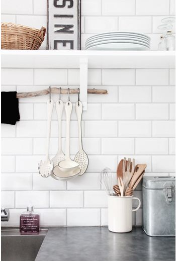 Forget about subway tile, I don't have it and I'm sick of it already! I love the stick used to hang kitchen things!
