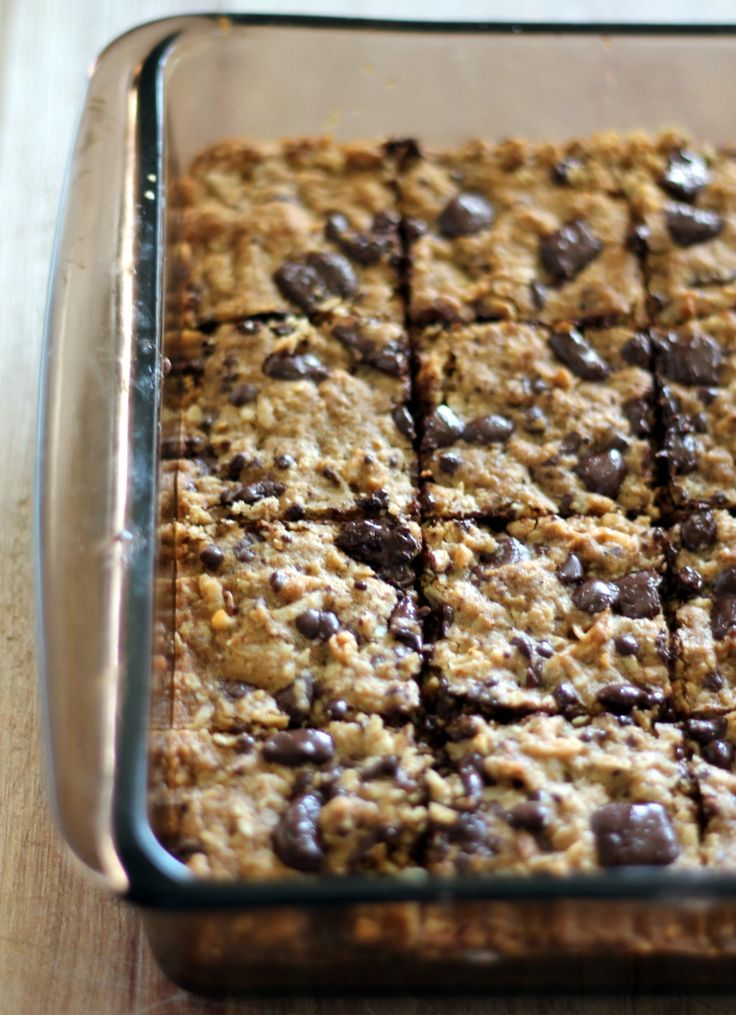 Delicious chewy coconut oatmeal bars with layers of dark chocolate. Made with coconut oil, too!