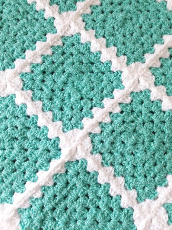 This green baby blanket has been handmade for a special baby close to your heart. Imagine a baby you know wrapped up all warm and cozy in this granny square baby blanket.  This mint green baby blanket is a great baby shower gift which would make your gift stand out from the crowd. Hand crafted shows how much you care.  This green crochet baby blanket measures 32x32 (81cm x 81cm) making it a great size for a receiving blanket, stroller blanket or car seat blanket keeping baby warm and cozy…