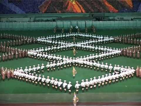 Mass games or mass gymnastics are a form of performing arts or gymnastics in which large numbers of performers take part in a highly regimented performance that emphasizes group dynamics rather than individual prowess. Because of the vast scale of the performance, with often tens of thousands of performers, mass games are performed in stadiums, often accompanied by a background of card-turners occupying the seats on the opposite side from the viewers.