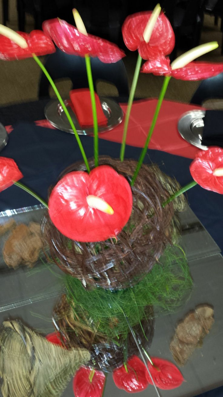 This is the Swazi themed centerpiece.  We used woven wood balls and red anthiriums.  The anthiriums represent the swazi shield