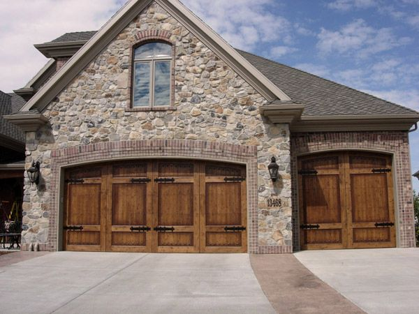 17 best ideas about carriage house garage doors on for Beautiful garage doors