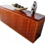 Mueble trinchador elaborado en Teca y cubierta en pergamino. Se puede elaborar la cubierta en otro tipo de material para bajar el costo.