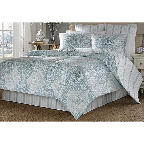 This comforter set by Stone Cottage features a soft blue watercolor print that…
