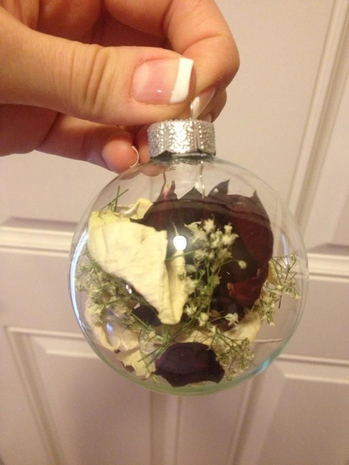 I got roses from my Grandma's Funeral and dried peddles before I put them in the glass ornament.  Nice little keepsake.  ENJOY!                                                                                                                                                                                 More